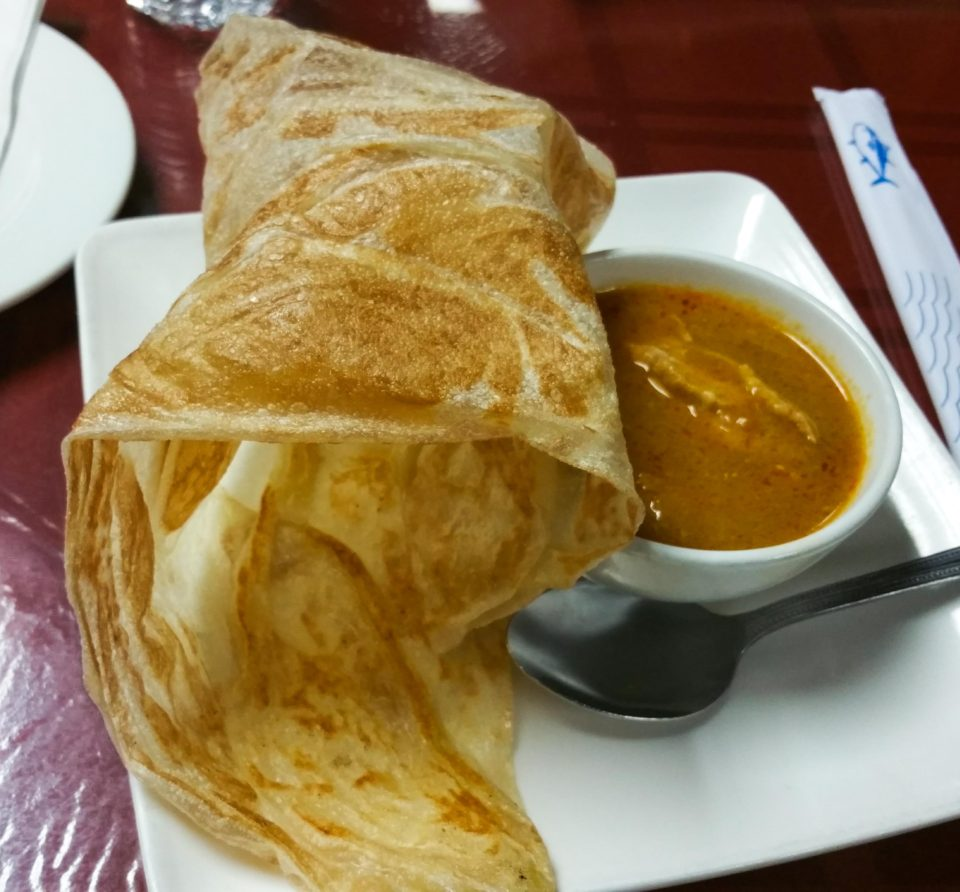 Indian influenced Malay dish - Roti Canai Indian influenced Malay dish - Roti Canai at Curry Leaves Malaysian Restaurant