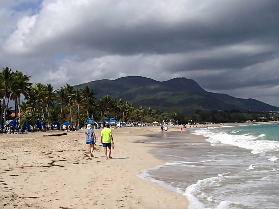 Playa Dorada, Puerto Plata, Dominican Republic - Brown sand beach entrenched between mountains making up a gorgeous setting.