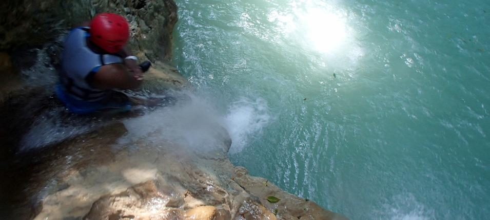 Sliding through the waters between 2 cascades of Damajagua Falls