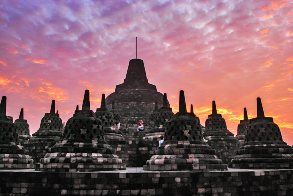 Top of Borobudur – few of the 72 perforated Stupas at Sunrise